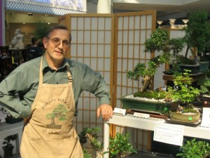 Klaus Schick standing at one of his Bonsai Stands